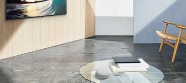 Image illustrant Google Nest Mini dans un salon